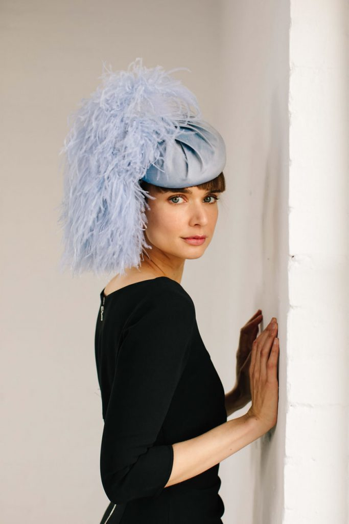 blue feather pom hat