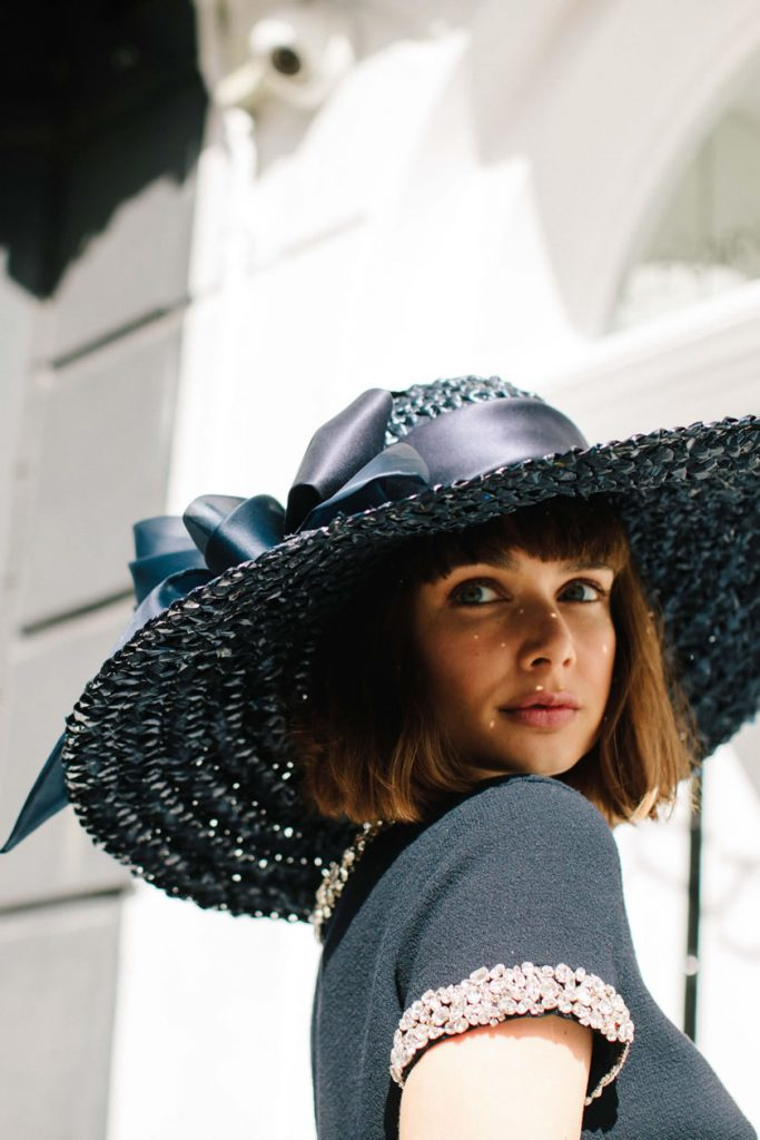 dramatic brim, bows and feathers